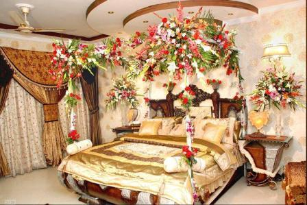 Flower designing of decorating bed room for wedding night for Asian wedding bed decoration