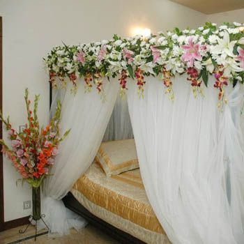 Flower designing of decorating bed room for wedding night Decoration for wedding room