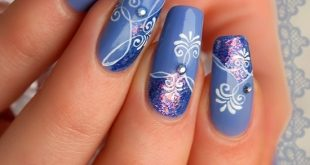 winter nail art ideas blue color with floral patterns